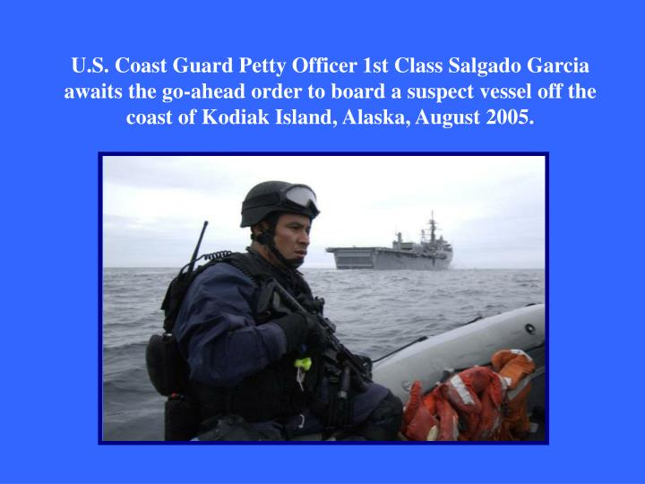 U.S. Coast Guard Petty Officer 1st Class Salgado Garcia awaits the go-ahead order to board a suspect vessel off the coast of Kodiak Island, Alaska, August 2005.