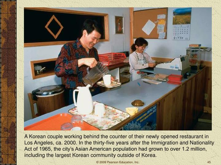 A Korean couple working behind the counter of their newly opened restaurant in Los Angeles, ca. 2000. In the thirty-five years after the Immigration and Nationality Act of 1965, the city's Asian American population had grown to over 1.2 million, including the largest Korean community outside of Korea.