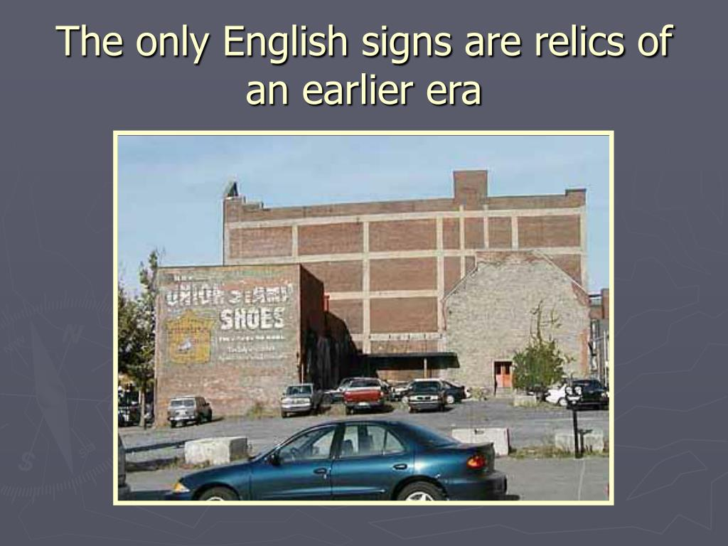 The only English signs are relics of an earlier era