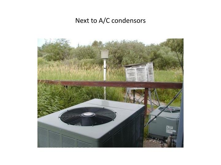 Next to A/C condensors