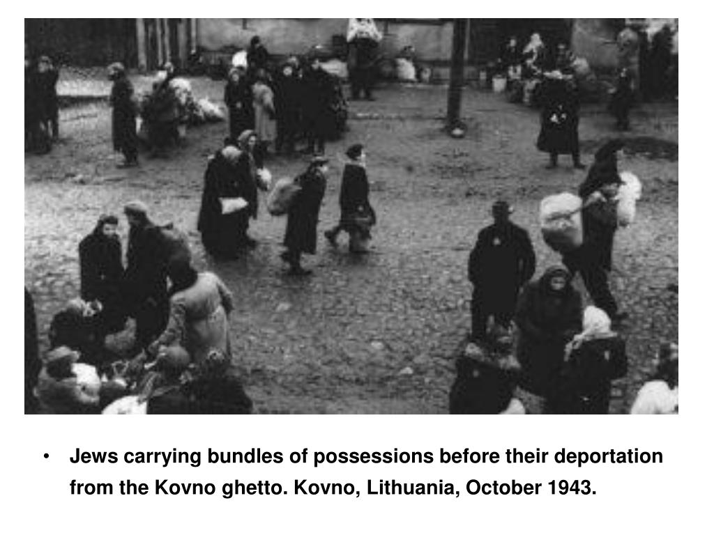 Jews carrying bundles of possessions before their deportation from the Kovno ghetto. Kovno, Lithuania, October 1943.