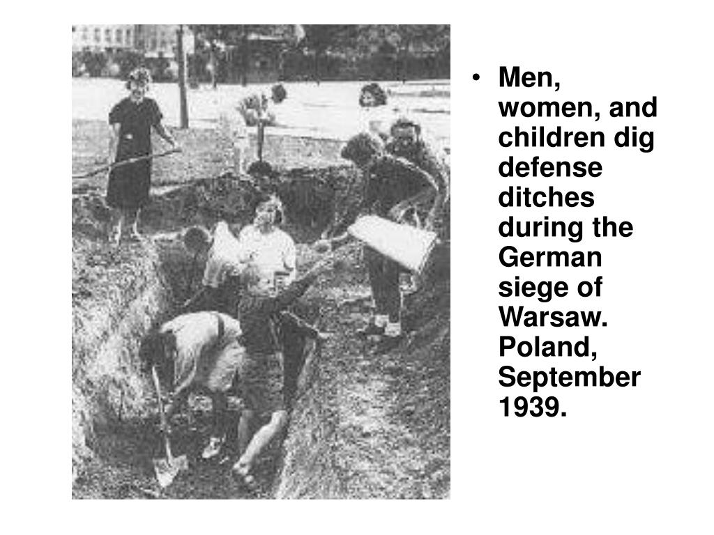 Men, women, and children dig defense ditches during the German siege of Warsaw. Poland, September 1939.
