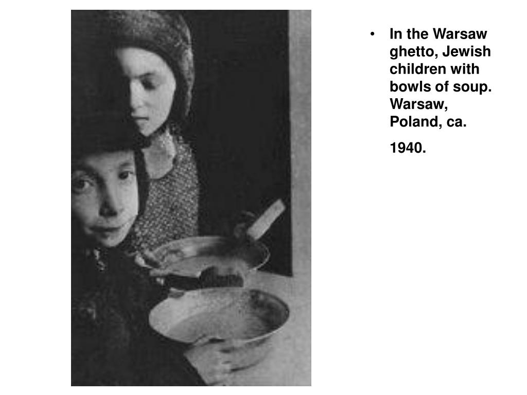 In the Warsaw ghetto, Jewish children with bowls of soup. Warsaw, Poland, ca. 1940.