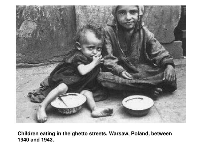 Children eating in the ghetto streets. Warsaw, Poland, between 1940 and 1943.