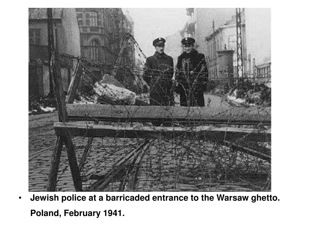 Jewish police at a barricaded entrance to the Warsaw ghetto. Poland, February 1941.