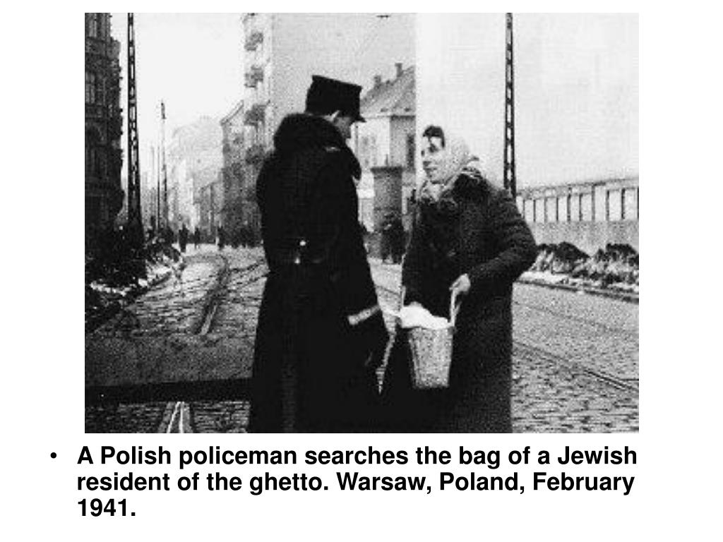 A Polish policeman searches the bag of a Jewish resident of the ghetto. Warsaw, Poland, February 1941.