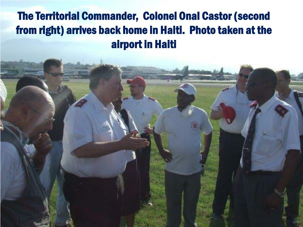 The Territorial Commander,  Colonel Onal Castor (second from right) arrives back home in Haiti.  Photo taken at the airport in Haiti
