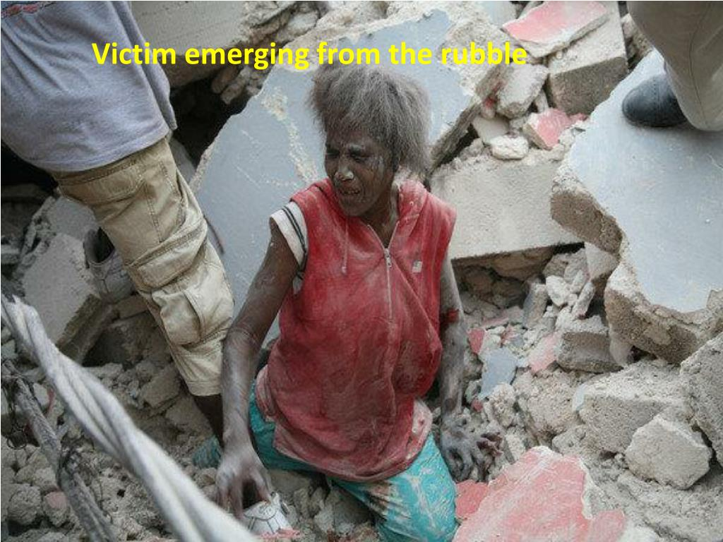 Victim emerging from the rubble