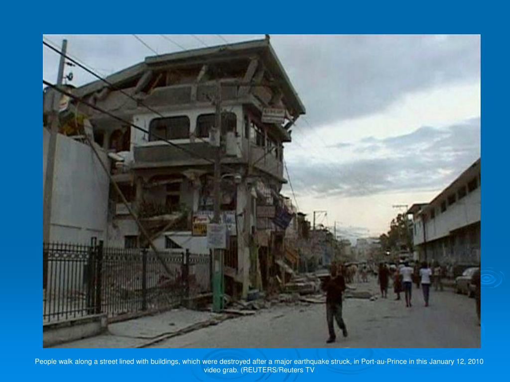 People walk along a street lined with buildings, which were destroyed after a major earthquake struck, in Port-au-Prince in this January 12, 2010 video grab. (REUTERS/Reuters TV
