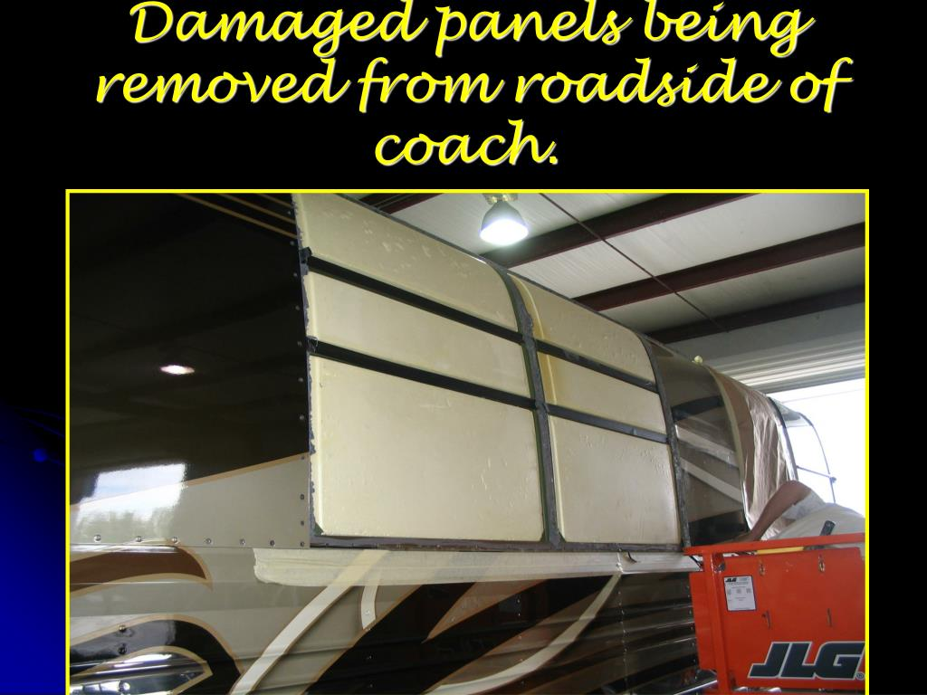 Damaged panels being removed from roadside of coach.