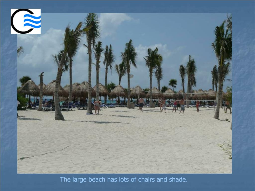The large beach has lots of chairs and shade.