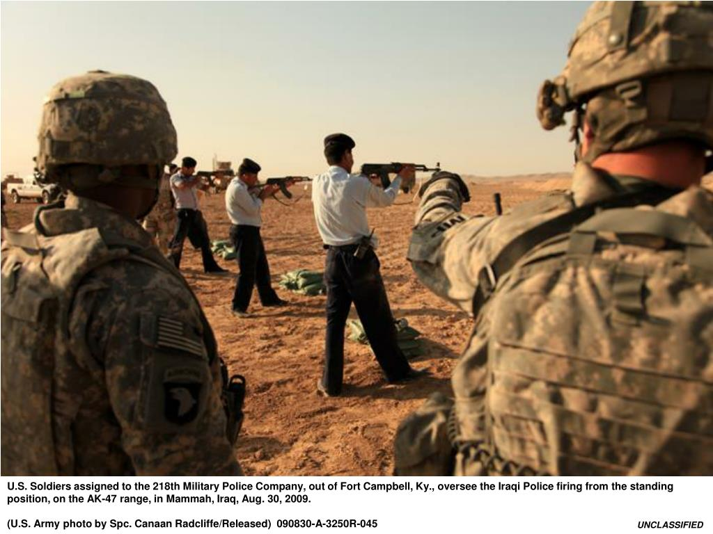 U.S. Soldiers assigned to the 218th Military Police Company, out of Fort Campbell, Ky., oversee the Iraqi Police firing from the standing position, on the AK-47 range, in