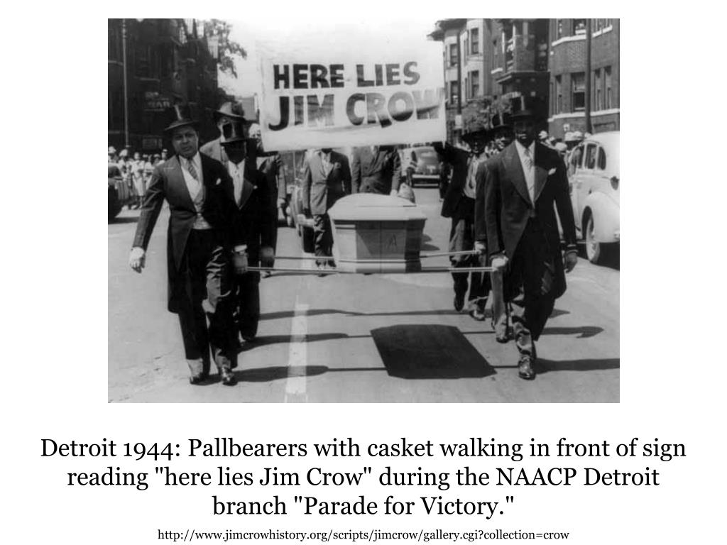 "Detroit 1944: Pallbearers with casket walking in front of sign reading ""here lies Jim Crow"" during the NAACP Detroit branch ""Parade for Victory."""