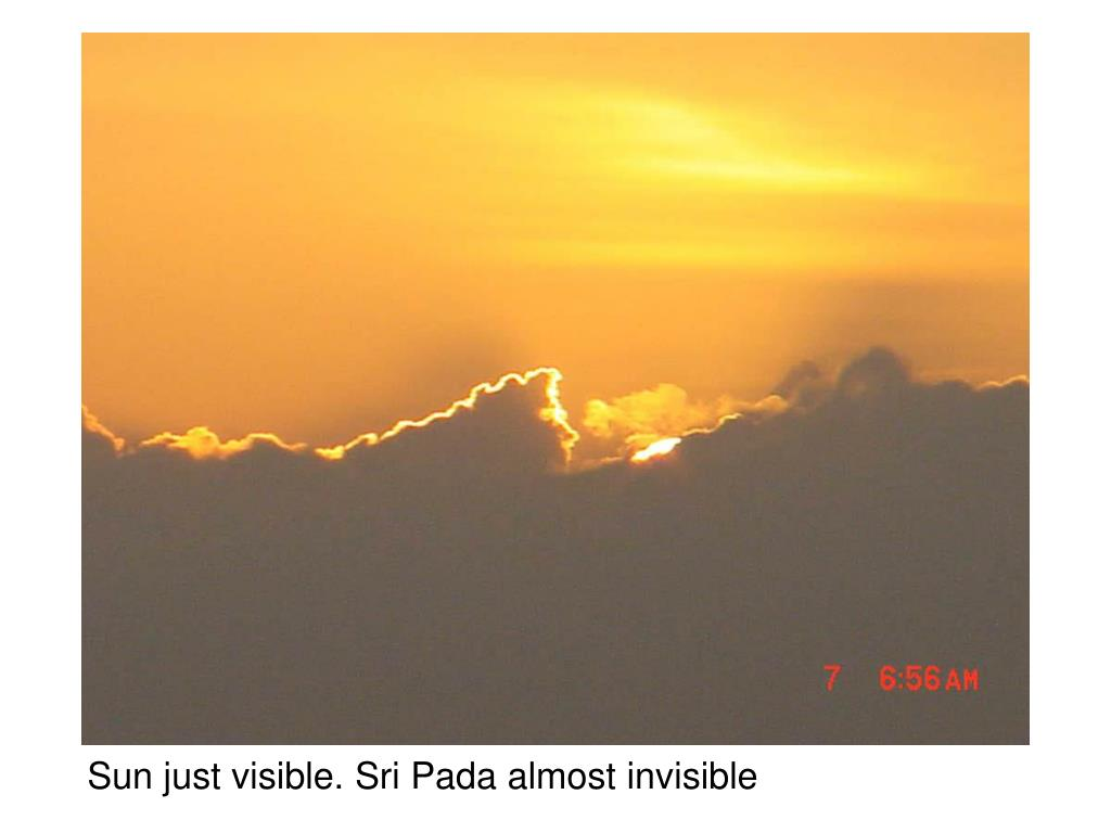 Sun just visible. Sri Pada almost invisible