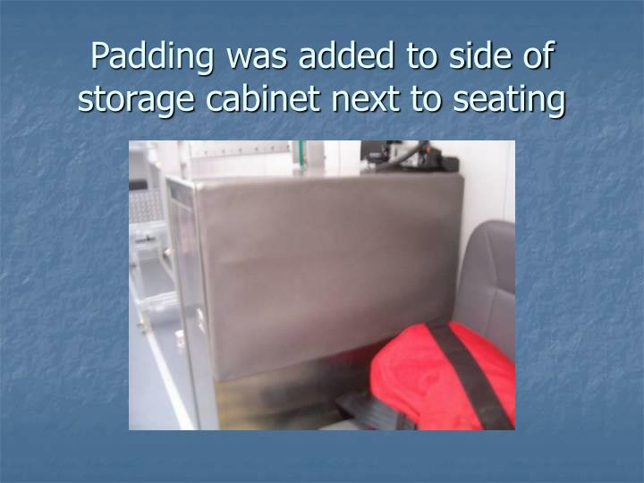 Padding was added to side of storage cabinet next to seating