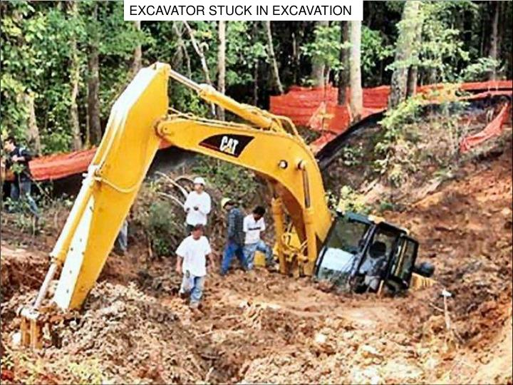EXCAVATOR STUCK IN EXCAVATION