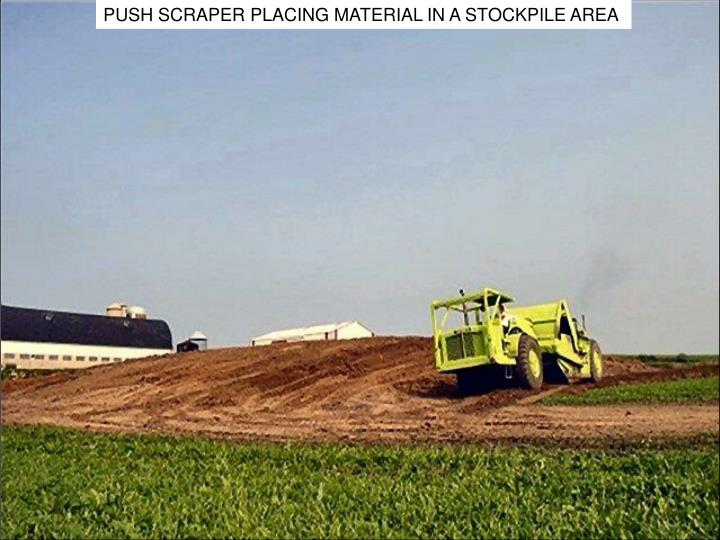 PUSH SCRAPER PLACING MATERIAL IN A STOCKPILE AREA