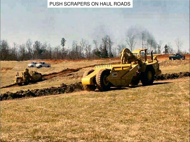 PUSH SCRAPERS ON HAUL ROADS