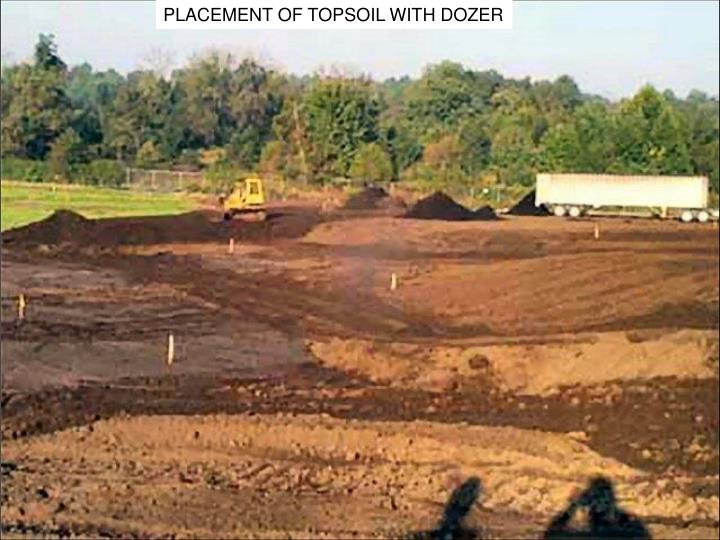 PLACEMENT OF TOPSOIL WITH DOZER