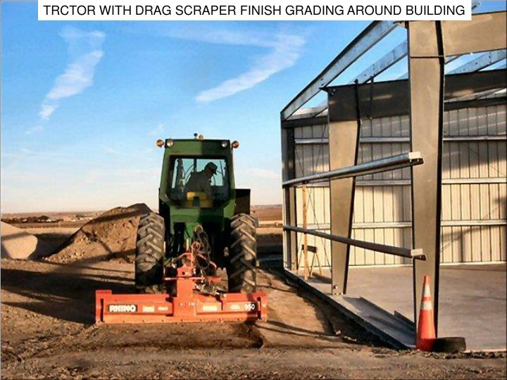 TRCTOR WITH DRAG SCRAPER FINISH GRADING AROUND BUILDING