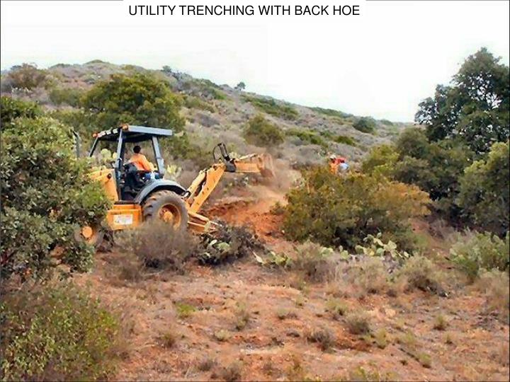 UTILITY TRENCHING WITH BACK HOE