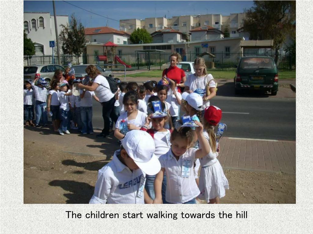 The children start walking towards the hill