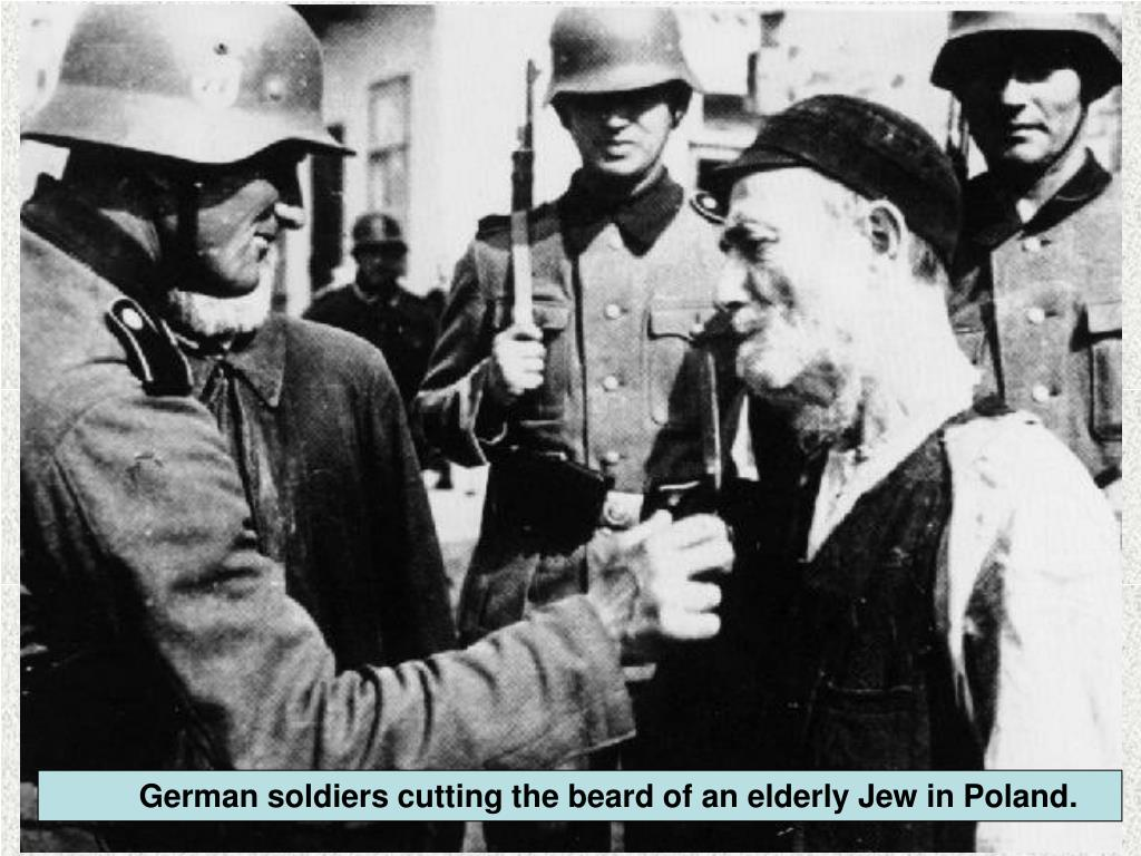 German soldiers cutting the beard of an elderly Jew in Poland.