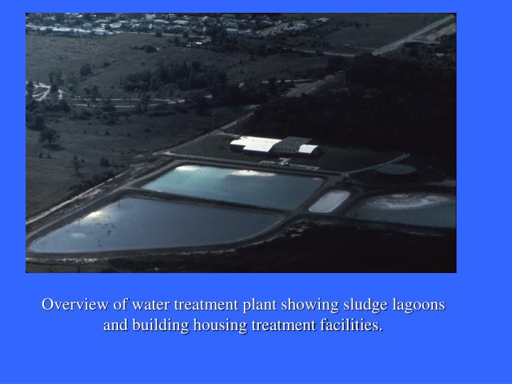 Overview of water treatment plant showing sludge lagoons and building housing treatment facilities.