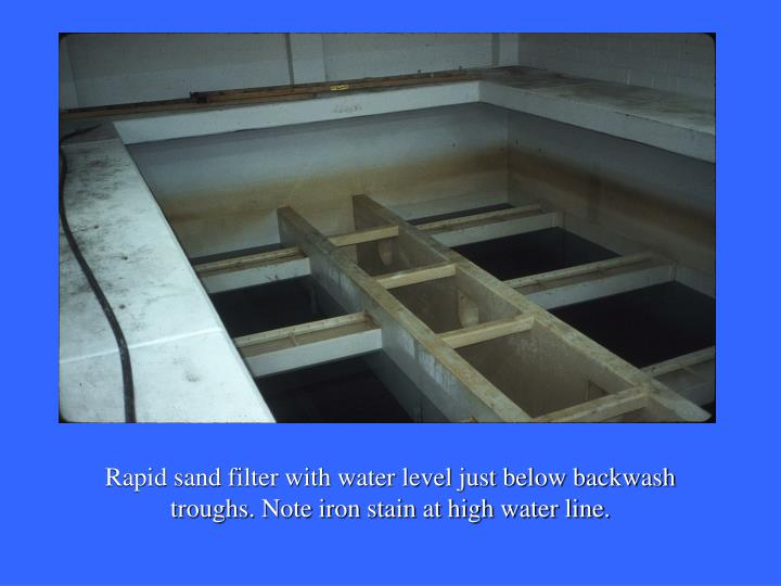 Rapid sand filter with water level just below backwash troughs. Note iron stain at high water line.