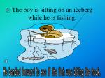 the boy is sitting on an iceberg while he is fishing