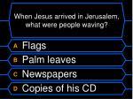 when jesus arrived in jerusalem what were people waving