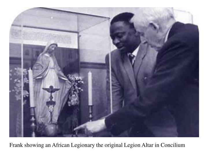 Frank showing an African Legionary the original Legion Altar in Concilium
