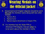 wearing medals on the official jacket