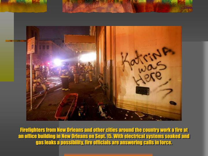 Firefighters from New Orleans and other cities around the country work a fire at an office building in New Orleans on Sept. 15. With electrical systems soaked and gas leaks a possibility, fire officials are answering calls in force.