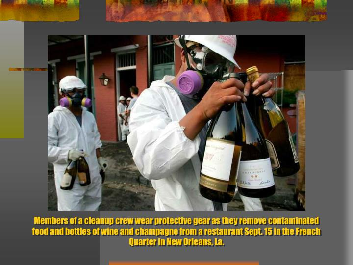 Members of a cleanup crew wear protective gear as they remove contaminated food and bottles of wine and champagne from a restaurant Sept. 15 in the French Quarter in New Orleans, La.