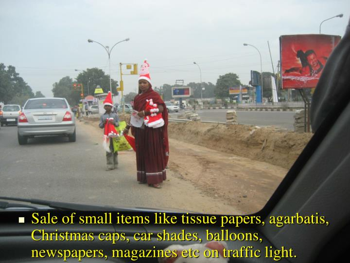 Sale of small items like tissue papers, agarbatis, Christmas caps, car shades, balloons, newspapers, magazines etc on traffic light.