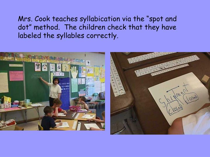 """Mrs. Cook teaches syllabication via the """"spot and dot"""" method.  The children check that they have labeled the syllables correctly."""