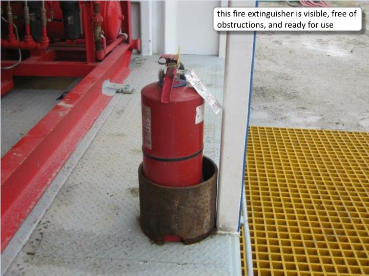 this fire extinguisher is visible, free of obstructions, and ready for use