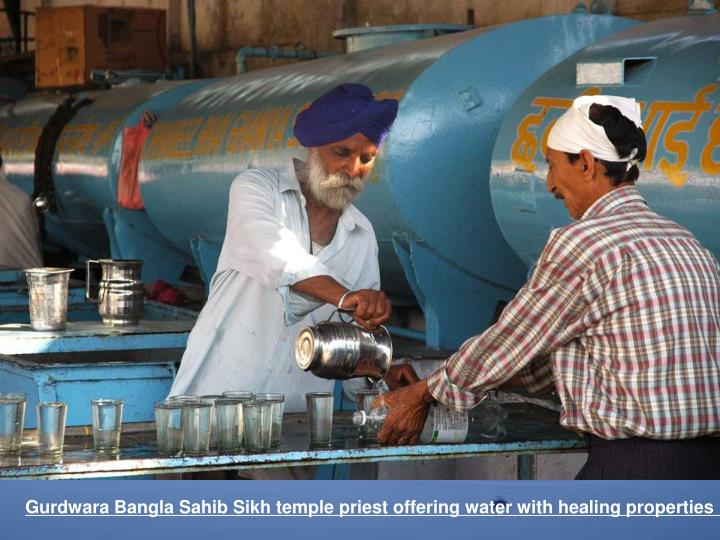 Gurdwara Bangla Sahib Sikh temple priest offering water with healing properties