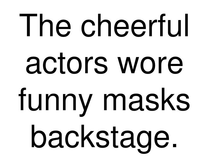 The cheerful actors wore funny masks backstage.
