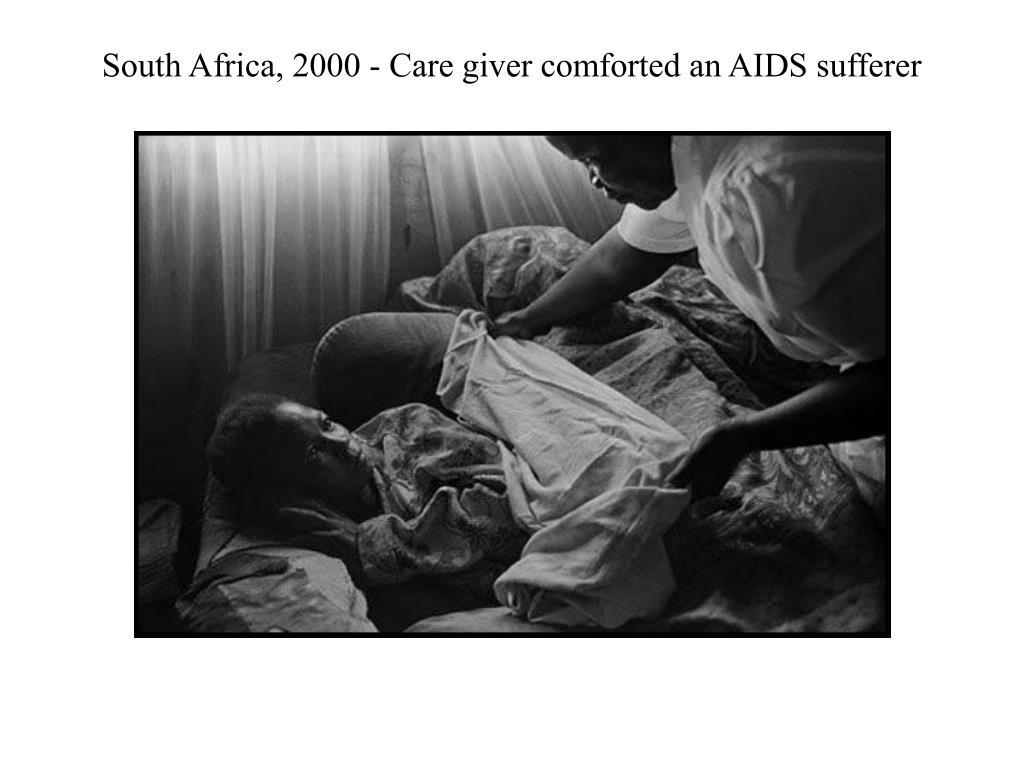 South Africa, 2000 - Care giver comforted an AIDS sufferer