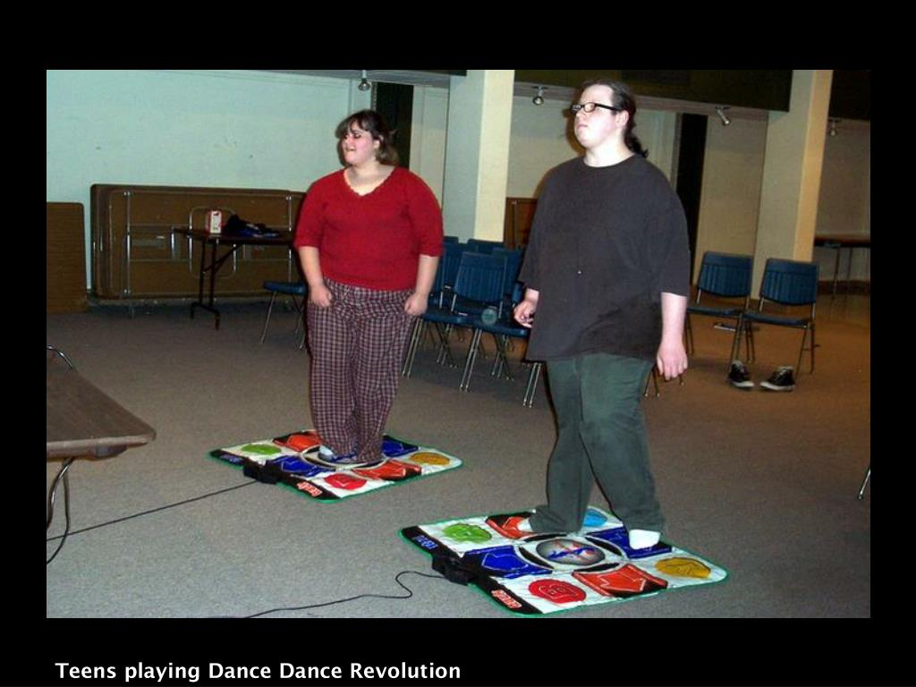 Teens playing Dance Dance Revolution