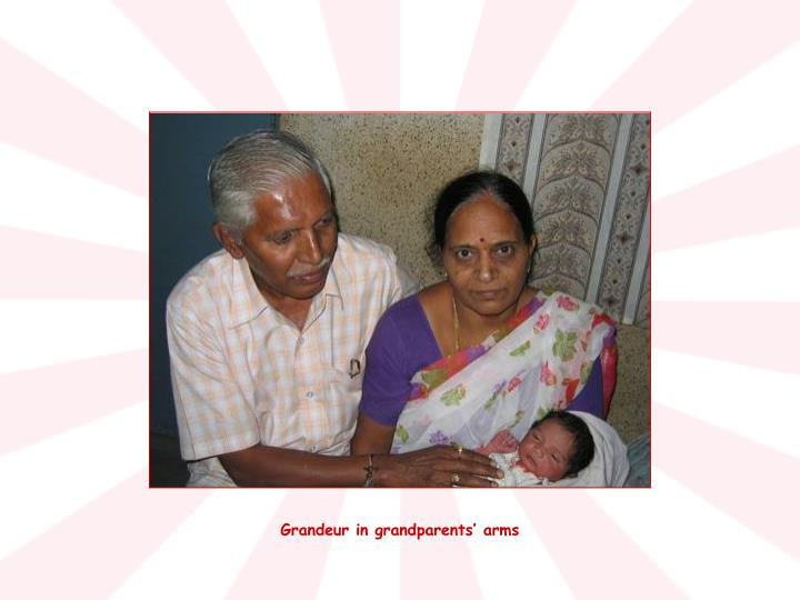 Grandeur in grandparents' arms