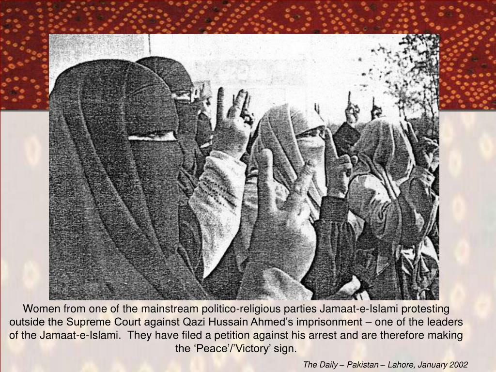 Women from one of the mainstream politico-religious parties Jamaat-e-Islami protesting outside the Supreme Court against Qazi Hussain Ahmed's imprisonment – one of the leaders of the Jamaat-e-Islami.  They have filed a petition against his arrest and are therefore making the 'Peace'/'Victory' sign.