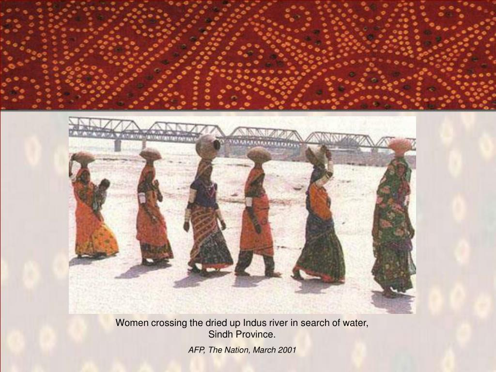 Women crossing the dried up Indus river in search of water, Sindh Province.