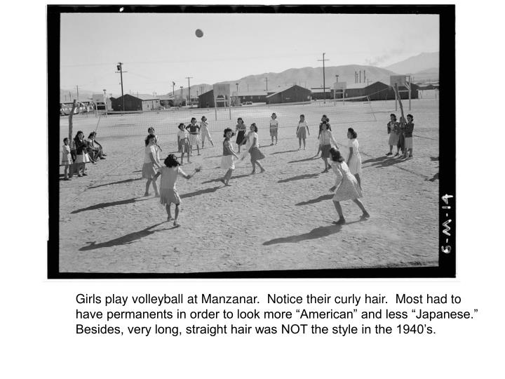 Girls play volleyball at Manzanar.  Notice their curly hair.  Most had to