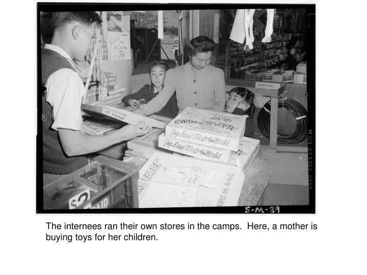The internees ran their own stores in the camps.  Here, a mother is