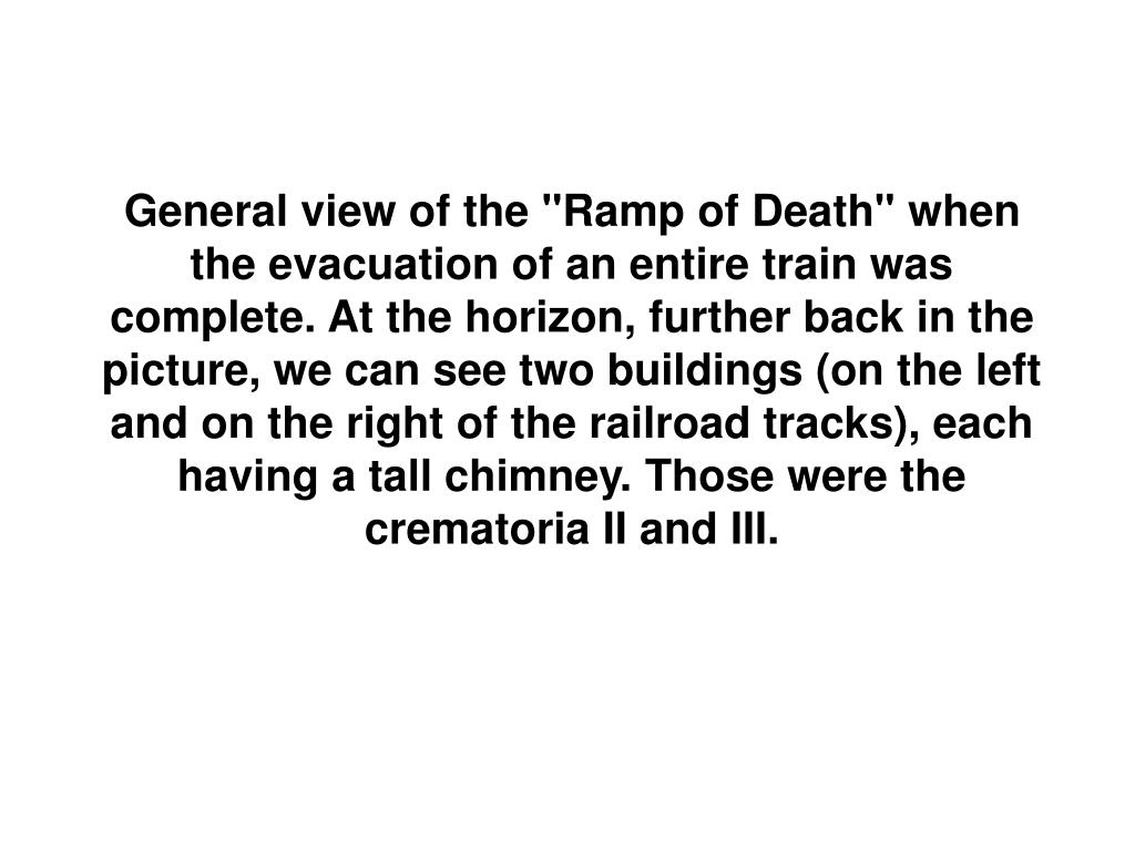 """General view of the """"Ramp of Death"""" when the evacuation of an entire train was complete. At the horizon, further back in the picture, we can see two buildings (on the left and on the right of the railroad tracks), each having a tall chimney. Those were the crematoria II and III."""