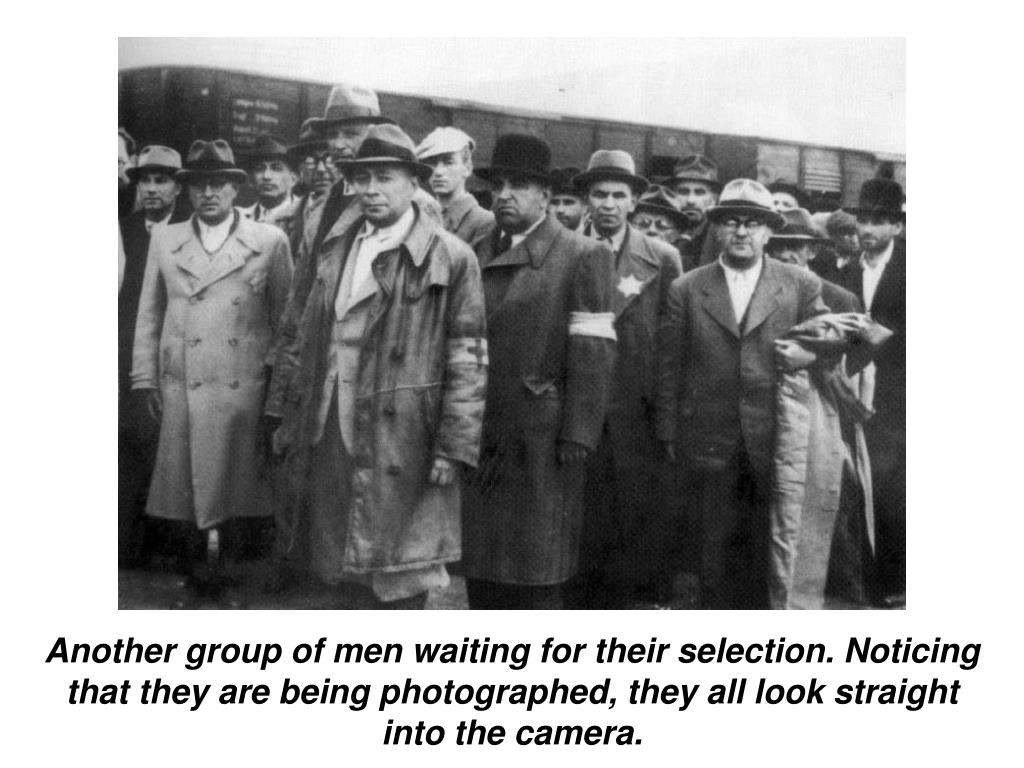 Another group of men waiting for their selection. Noticing that they are being photographed, they all look straight into the camera.