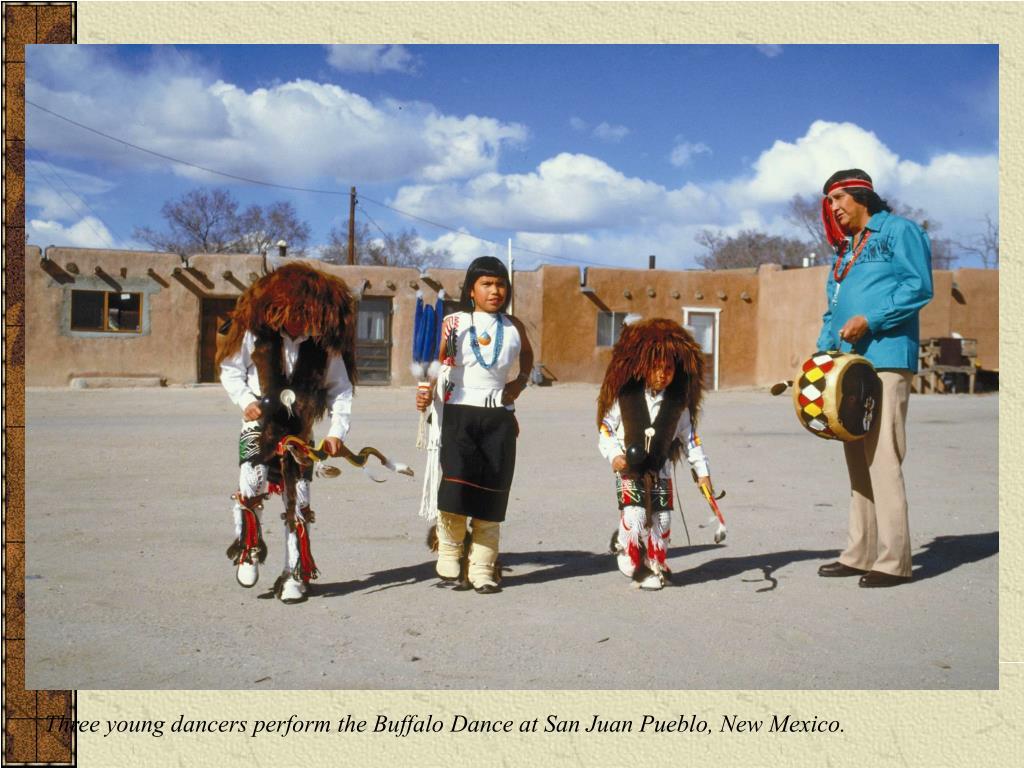 Three young dancers perform the Buffalo Dance at San Juan Pueblo, New Mexico.